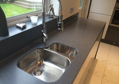 Corian Midnight Worktop with Coved Upstand running in to window sill