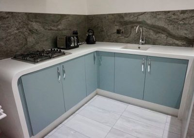 Krion Polar Stone Worktop with Waterfall Return to Floor